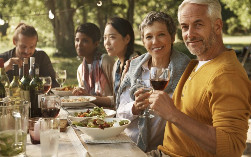 Portrait of a mature couple enjoying an out door meal with family and friendshttp://195.154.178.81/DATA/istock_collage/a5/shoots/785125.jpg